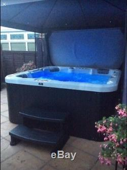 Balboa Hot Tub Jacuzzi with steps and insulated cover
